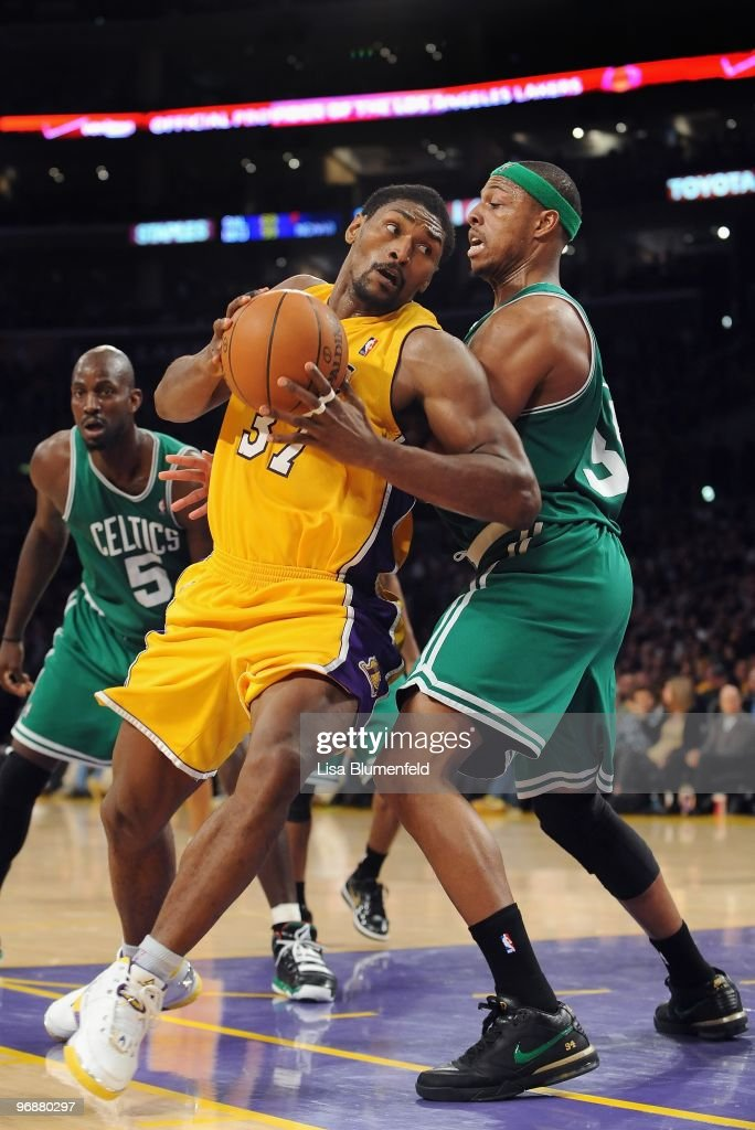 Ron Artest #37 of the Los Angeles Lakers drives to the basket against Paul Pierce #34 of the Boston Celtics at Staples Center on February 18, 2010 in Los Angeles, California.