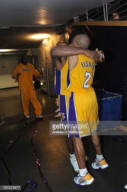 Ron Artest of the Los Angeles Lakers is hugged by teammate Derek Fisher in the tunnel after making the gamewinning shot against the Phoenix Suns in...