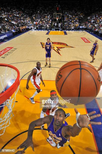 Ron Artest of the Los Angeles Lakers shoots a layup against Corey Maggette of the Golden State Warriors during the game at Oracle Arena on March 15...