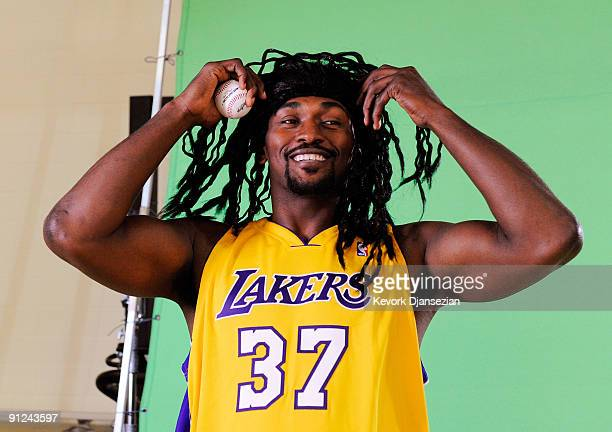 Ron Artest of the Los Angeles Lakers wears a wig to resemble baseball player Manny Ramirez while taping a public announcement for the Los Angeles...