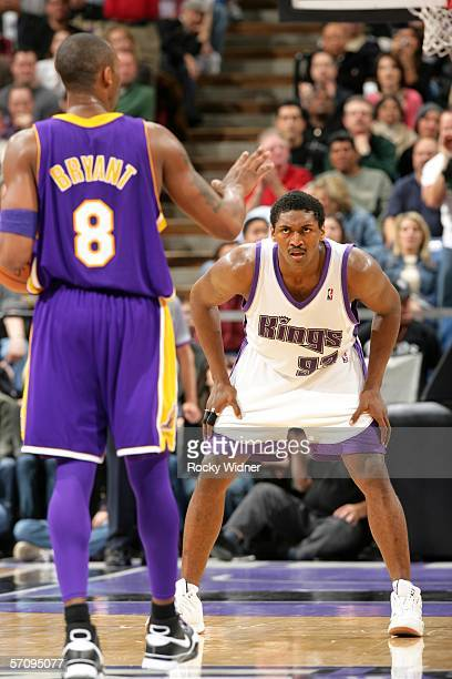 Ron Artest of the Sacramento Kings gets ready to play defense on Kobe Bryant of the Los Angeles Lakers on March 14 2006 at the ARCO Arena in...