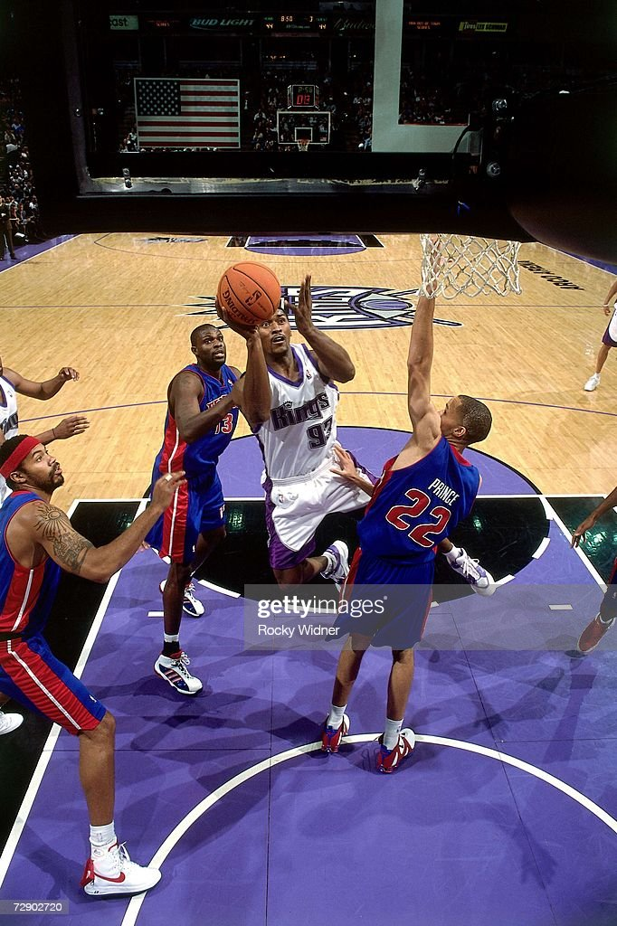 Ron Artest #93 of the Sacramento Kings goes up for a shot against Tayshaun Prince #22 of the Detroit Pistons during a game at Arco Arena on November 8, 2006 in Sacramento, California. The Kings won 99-86.