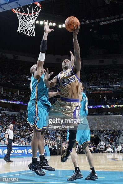 Ron Artest of the Sacramento Kings makes a shot over David West of the New Orleans/Oklahoma City Hornets on January 26 2006 at the New Orleans Arena...