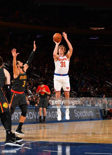 Ron Baker of the New York Knicks shoots the ball against the Atlanta Hawks at Madison Square Garden on December 10 2017 in New York New York NOTE TO...
