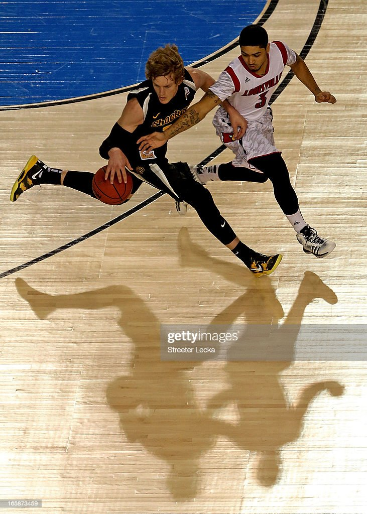 Ron Baker #31 of the Wichita State Shockers brings the ball up court in the second half against <a gi-track='captionPersonalityLinkClicked' href=/galleries/search?phrase=Peyton+Siva&family=editorial&specificpeople=5792001 ng-click='$event.stopPropagation()'>Peyton Siva</a> #3 of the Louisville Cardinals during the 2013 NCAA Men's Final Four Semifinal at the Georgia Dome on April 6, 2013 in Atlanta, Georgia.