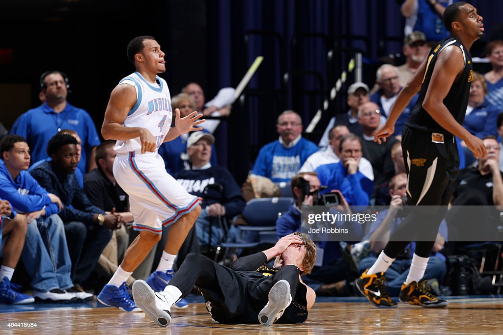 Ron Baker #31 of the Wichita State Shockers reacts after being hit in the face during the game against the Indiana State Sycamores at Hulman Center on February 25, 2015 in Terre Haute, Indiana. Wichita State defeated Indiana State 63-53.