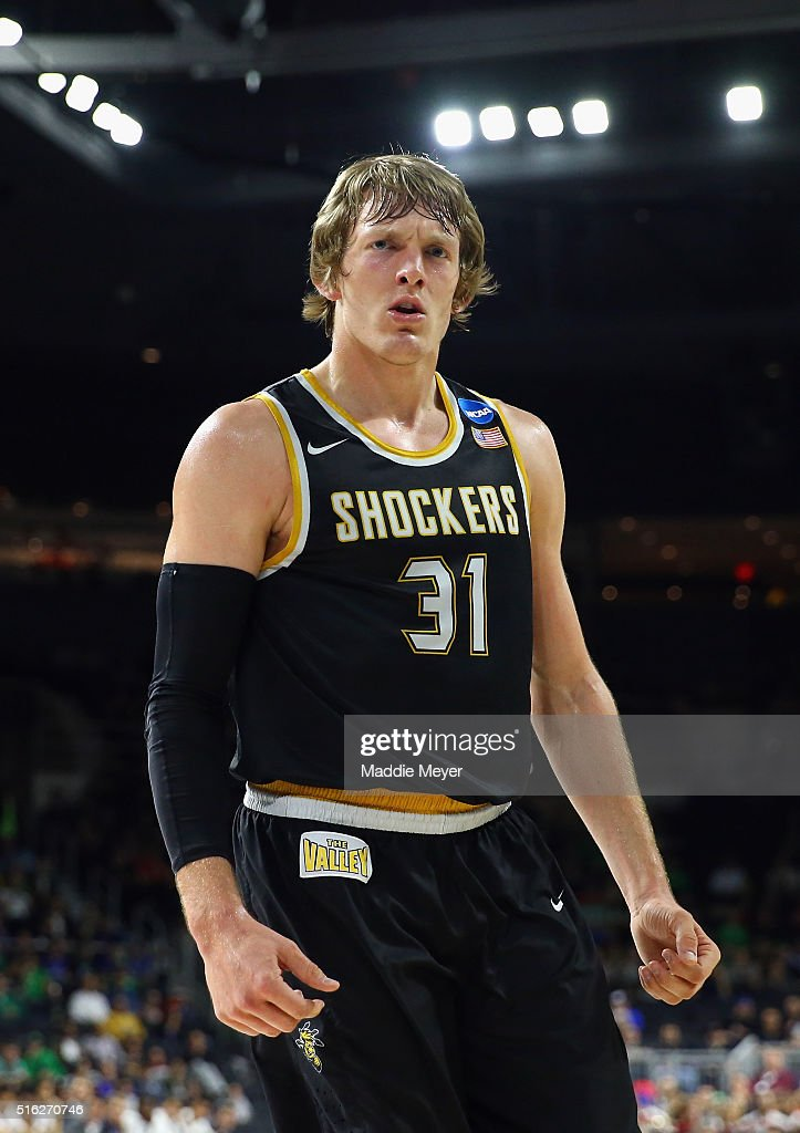 Ron Baker #31 of the Wichita State Shockers reacts in the first half against the Arizona Wildcats during the first round of the 2016 NCAA Men's Basketball Tournament at Dunkin' Donuts Center on March 17, 2016 in Providence, Rhode Island.
