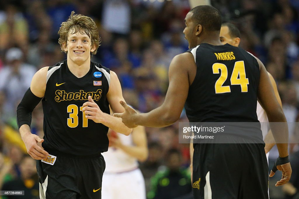 Ron Baker #31 of the Wichita State Shockers reacts with teammate Shaquille Morris #24 against the Kansas Jayhawks in the second half during the third round of the 2015 NCAA Men's Basketball Tournament at the CenturyLink Center on March 22, 2015 in Omaha, Nebraska.