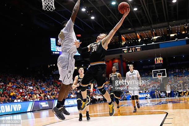 Ron Baker of the Wichita State Shockers shoots the ball against Damian Jones of the Vanderbilt Commodores in the second half of their game during the...