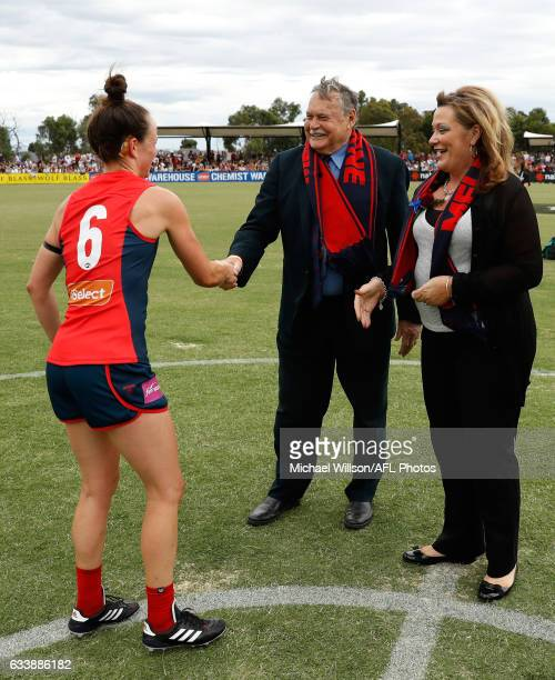 Ron Barassi and Daisy Pearce of the Demons shake hands during the 2017 AFLW Round 01 match between the Melbourne Demons and the Brisbane Lions at...