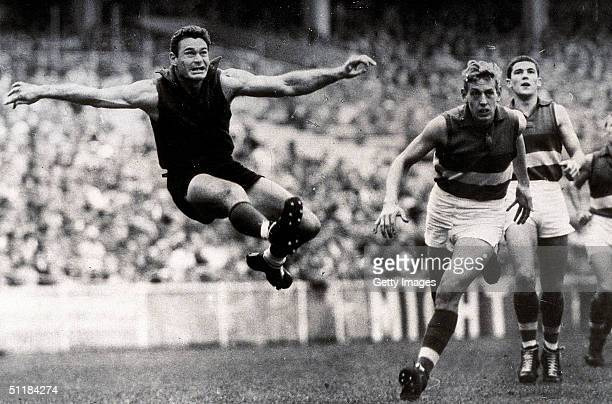 Ron Barassi of the Melbourne Demons in action during a VFL match held in Melbourne Australia
