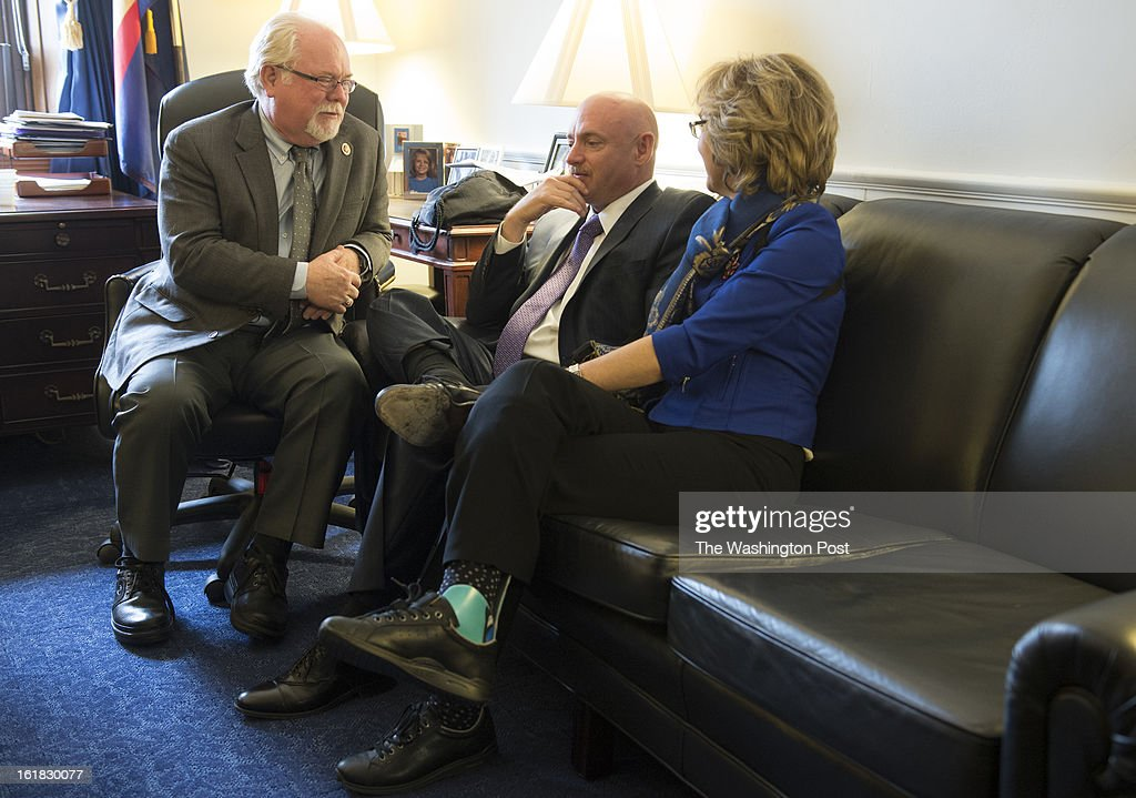 Ron Barber who replaced Gabrielle Giffords as U.S. Representative for Arizona's 2nd Congressional District chats with Mark Kelly and Giffords during their visit to talk about the issue of gun violence on Capitol Hill in Washington, D.C., on Wednesday, February 13, 2013. Barber was also injured in the Arizona shooting which severely injured Giffords forcing her to give up her congressional seat.