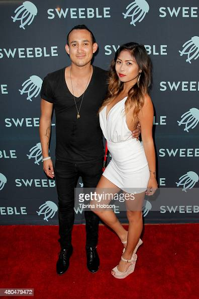 Ron Beem and Emilynn attend the Sweeble and Arsenic Magazine party on July 11 2015 in Studio City California