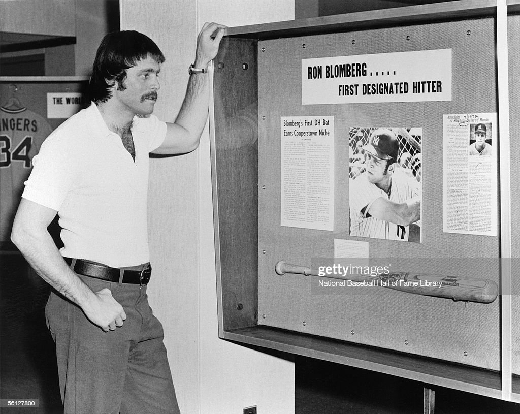 Ron Blomberg of the New York Yankees stands in front of a display comomerating 'Bloomberg' as the firts major league's designated hitter Ron Blomberg...