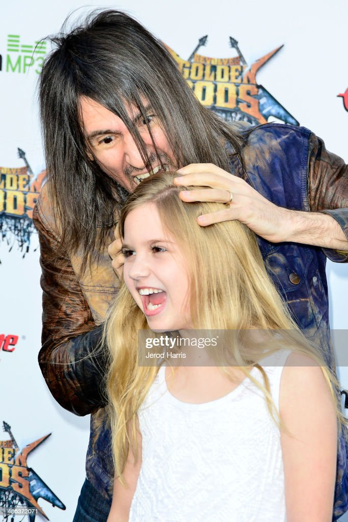 Ron 'Bumblefoot' Thal and Kyla Kennedy arrive at the 2014 Revolver Golden Gods Awards at Club Nokia on April 23, 2014 in Los Angeles, California.