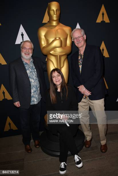 Ron Clements Osnat Shurer and John Musker who are nominated for their film 'Moana' arrive at a reception featuring the 2016 Oscar nominated films in...