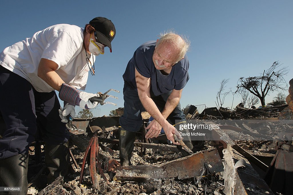 Ron Cole R And His Wife Maria Search For Retrievable Possessions In The