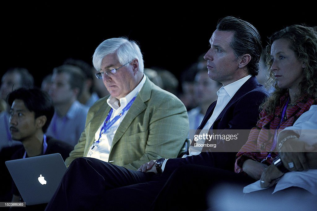 Ron Conway, founder of SV Angel, left, and Gavin Newsom, lieutenant governor of California, listen during a keynote address at the DreamForce Conference in San Francisco, California, U.S., on Wednesday, Sept. 19, 2012. Salesforce.com Inc. said it's releasing a new version of its software for tablet computers and unifying its social-media marketing products into a single suite, as it races to stay ahead of new market entrants. Photographer: David Paul Morris/Bloomberg via Getty Images
