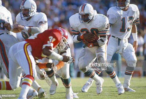 Ron Davenport of the Miami Dolphins carries the ball against the Kansas City Chiefs during an NFL football game September 22 1985 at the Orange Bowl...