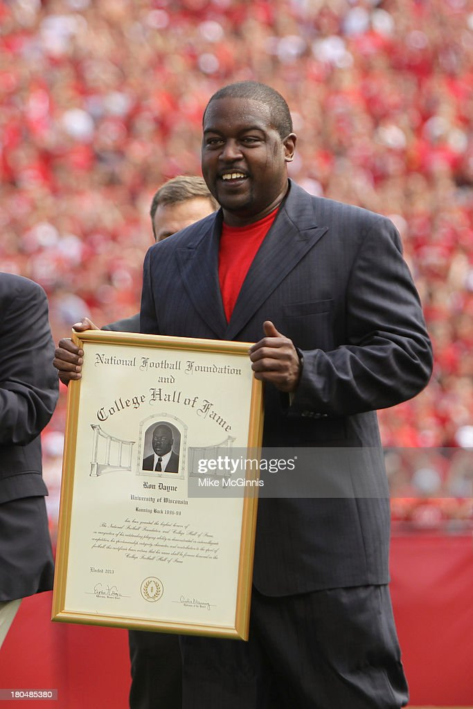 <a gi-track='captionPersonalityLinkClicked' href=/galleries/search?phrase=Ron+Dayne&family=editorial&specificpeople=213195 ng-click='$event.stopPropagation()'>Ron Dayne</a> of the Wisconsin Badgers receives an award putting him in the College Hall of Fame during the game against the Tennessee Tech Golden Eagles at Camp Randall Stadium on September 07, 2013 in Madison, Wisconsin.