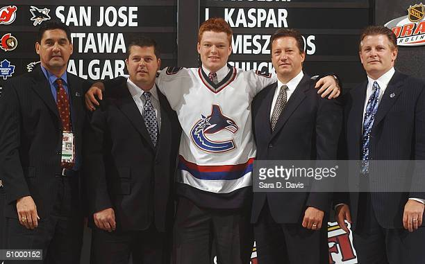Ron Delorme Dave Nonis #26 overall draft pick Cory Schneider general manager Steve Tambellini and Marc Crawford of the Vancouver Canucks during the...