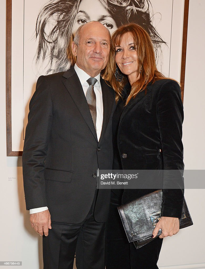 Ron Dennis and Carol Weatherall attend a private view of Bailey's Stardust a exhibition of images by David Bailey supported by Hugo Boss at the...
