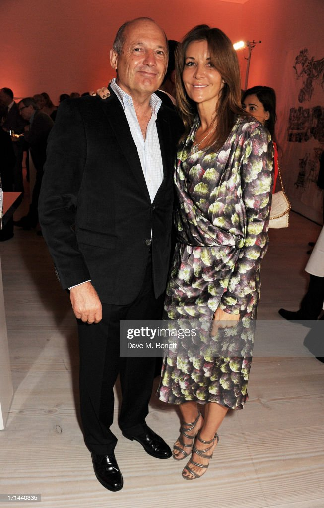 <a gi-track='captionPersonalityLinkClicked' href=/galleries/search?phrase=Ron+Dennis&family=editorial&specificpeople=210506 ng-click='$event.stopPropagation()'>Ron Dennis</a> (L) and Carol Weatherall attend the 'Arts For Life' charity auction hosted by Susan Hayden, Nadja Swarovski and Natalia Vodianova to raise funds for Borne, a research programme on premature birth, at the Saatchi Gallery on June 24, 2013 in London, England.
