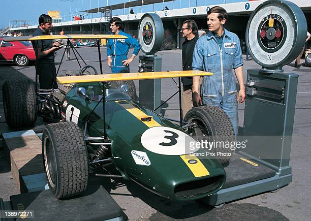 Ron Dennis oversees the scrutineering and weighing of the double high winged Brabham Racing Organisation Brabham BT26 Repco V8 of Jack Brabham during...