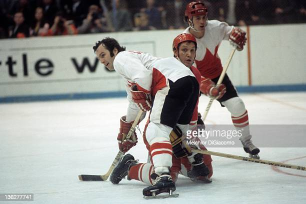 Ron Ellis and Paul Henderson of Canada defend against an unidentified player from the Soviet Union during the 1972 Summit Series at the Luzhniki Ice...