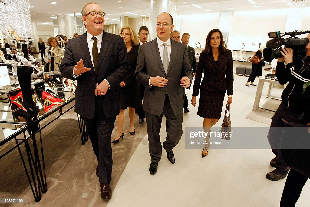 Ron Frasch Vice Chairman of SAKS Fifth Avenue leads Albert II Prince of Monaco on a tour of the shoe floor at SAKS Fifth Avenue during his appearence...