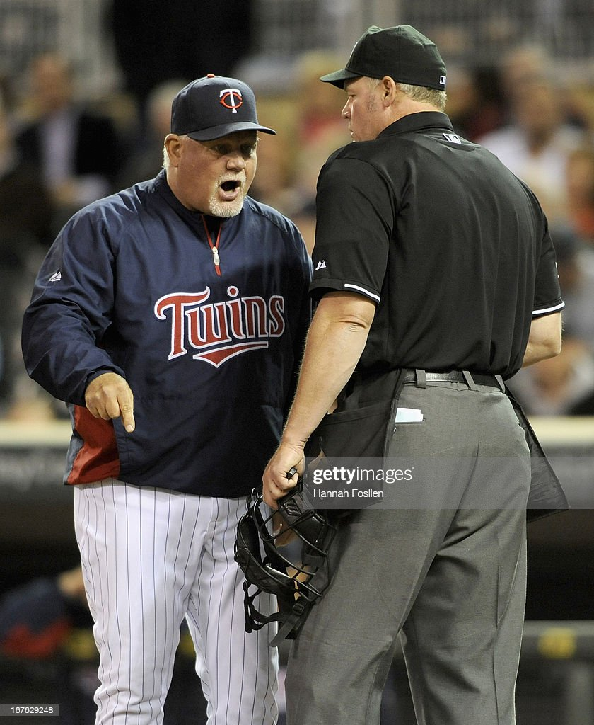 Ron Gardenhire #35 of the Minnesota Twins argues with home plate umpire Ted Barrett #65 after Chris Parmelee #27 was called out on strikes during the ninth inning of the game against the Texas Rangers on April 26, 2013 at Target Field in Minneapolis, Minnesota. The Rangers defeated the Twins 4-3.