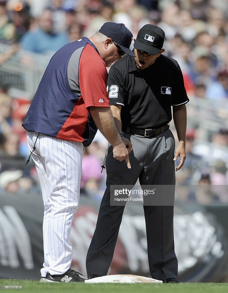 <a gi-track='captionPersonalityLinkClicked' href=/galleries/search?phrase=Ron+Gardenhire&family=editorial&specificpeople=220870 ng-click='$event.stopPropagation()'>Ron Gardenhire</a> #35 of the Minnesota Twins argues with third base umpire Alfonso Marquez #72 after Oswaldo Arcia #31 was called out during the seventh inning of the game against the Texas Rangers on April 28, 2013 at Target Field in Minneapolis, Minnesota. The Twins defeated the Ranger 5-0.