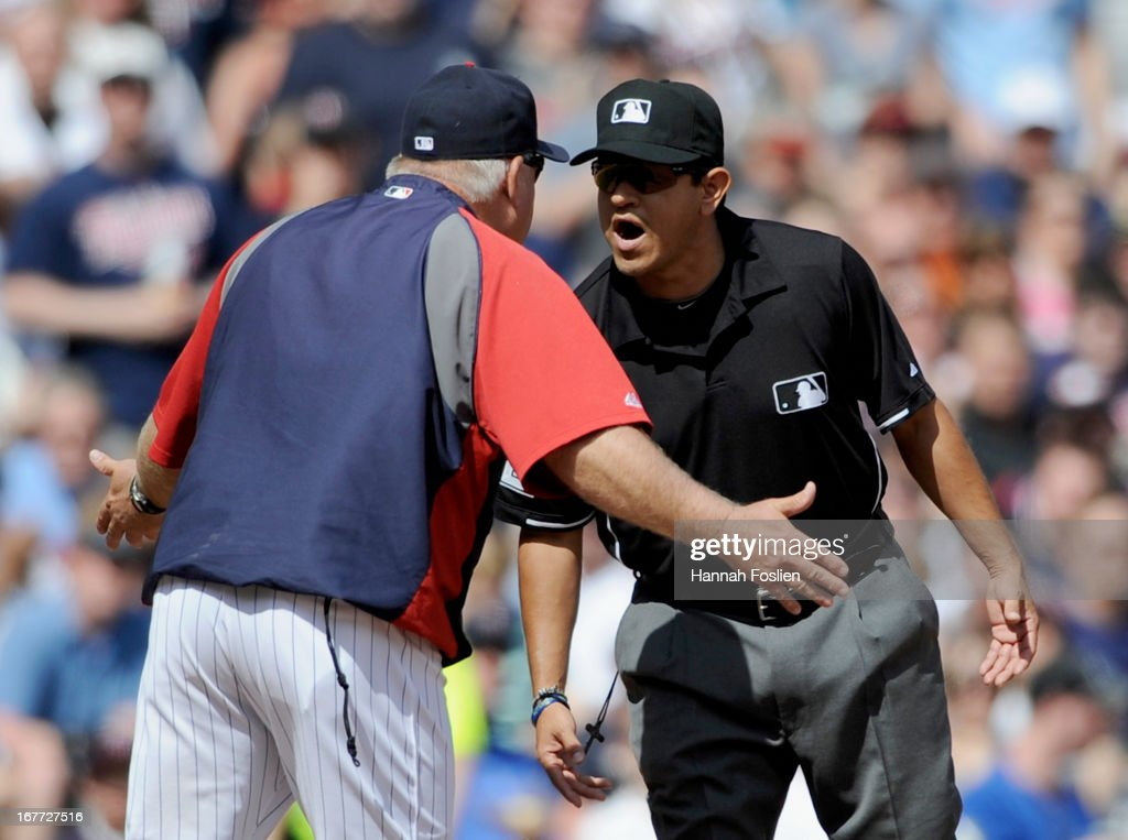 Ron Gardenhire #35 of the Minnesota Twins argues with third base umpire Alfonso Marquez #72 after Oswaldo Arcia #31 was called out during the seventh inning of the game against the Texas Rangers on April 28, 2013 at Target Field in Minneapolis, Minnesota. The Twins defeated the Ranger 5-0.