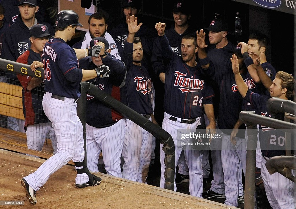 <a gi-track='captionPersonalityLinkClicked' href=/galleries/search?phrase=Ron+Gardenhire&family=editorial&specificpeople=220870 ng-click='$event.stopPropagation()'>Ron Gardenhire</a> #35 of the Minnesota Twins congratulates <a gi-track='captionPersonalityLinkClicked' href=/galleries/search?phrase=Josh+Willingham&family=editorial&specificpeople=537640 ng-click='$event.stopPropagation()'>Josh Willingham</a> #16 on a solo home run against the Philadelphia Phillies during the sixth inning on June 12, 2012 at Target Field in Minneapolis, Minnesota.