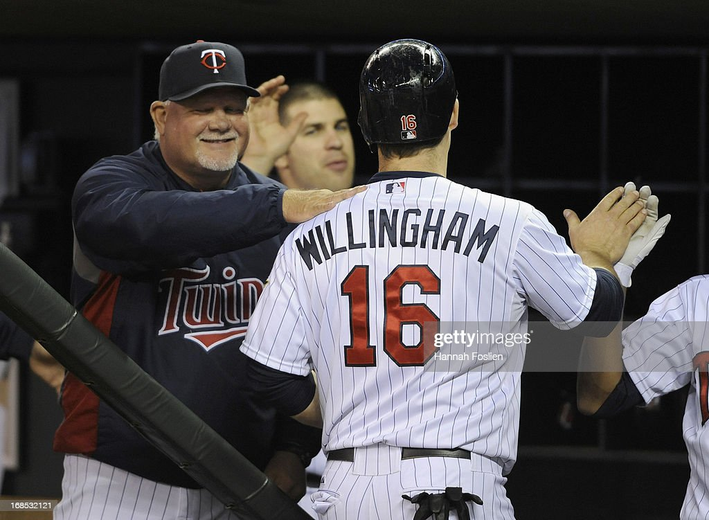 Ron Gardenhire #35 of the Minnesota Twins congratulates Josh Willingham #16 on scoring a run against the Baltimore Orioles during the fifth inning of the game on May 10, 2013 at Target Field in Minneapolis, Minnesota.