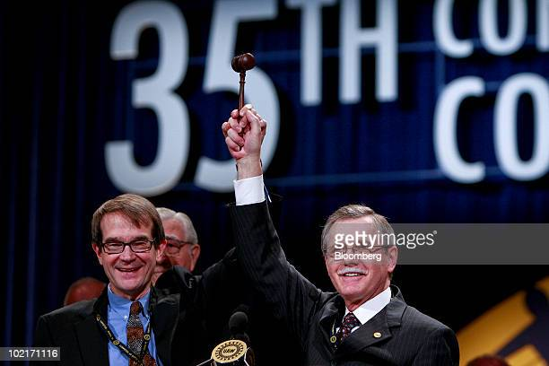 Ron Gettelfinger outgoing United Auto Workers union president right passes the gavel to his successor Bob King during the UAW 35th Constitutional...