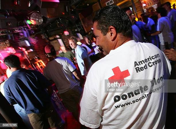Ron Graham a volunteer with the American Red Cross and a worker with California phone company SBC enjoys the scene at the Bourbon Steet Blues Company...