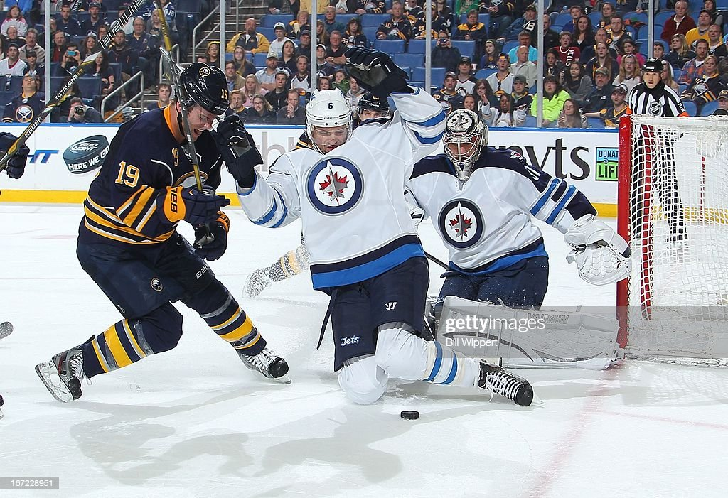 <a gi-track='captionPersonalityLinkClicked' href=/galleries/search?phrase=Ron+Hainsey&family=editorial&specificpeople=206345 ng-click='$event.stopPropagation()'>Ron Hainsey</a> #6 and Ondrej Pavelec #31 of the Winnipeg Jets combine to stop <a gi-track='captionPersonalityLinkClicked' href=/galleries/search?phrase=Cody+Hodgson&family=editorial&specificpeople=4151192 ng-click='$event.stopPropagation()'>Cody Hodgson</a> #19 of the Buffalo Sabres on April 22, 2013 at the First Niagara Center in Buffalo, New York. Winnipeg defeated Buffalo, 2-1.