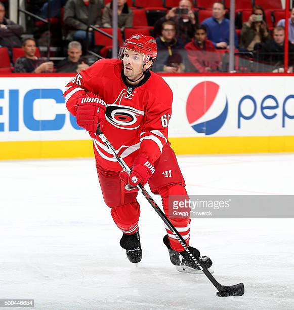 Ron Hainsey of the Carolina Hurricanes carries the puck during a NHL game against the New Jersey Devils at PNC Arena on December 3 2015 in Raleigh...