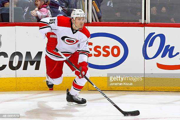 Ron Hainsey of the Carolina Hurricanes carries the puck up the ice during third period action against the Winnipeg Jets at the MTS Centre on March 22...