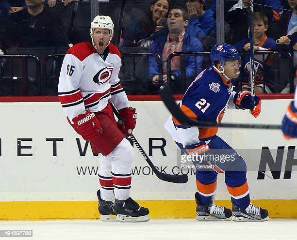 Ron Hainsey of the Carolina Hurricanes celebrates his game winning goal at 221 of the overtime against the New York Islanders at the Barclays Center...