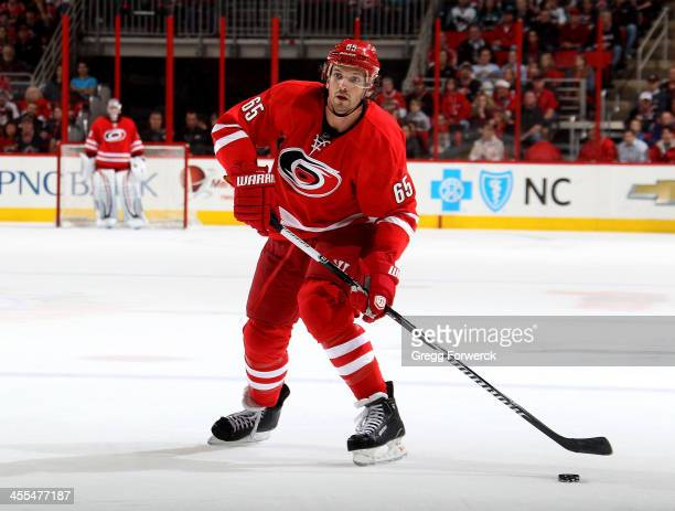 Ron Hainsey of the Carolina Hurricanes looks to pass the puck during their NHL game against the San Jose Sharks at PNC Arena on December 6 2013 in...