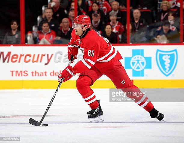 Ron Hainsey of the Carolina Hurricanes looks to pass the puck during a NHL game against the Florida Panthers at PNC Arena on October 13 2015 in...
