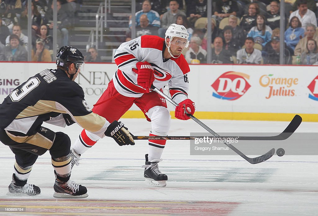 <a gi-track='captionPersonalityLinkClicked' href=/galleries/search?phrase=Ron+Hainsey&family=editorial&specificpeople=206345 ng-click='$event.stopPropagation()'>Ron Hainsey</a> #65 of the Carolina Hurricanes moves the puck in front of <a gi-track='captionPersonalityLinkClicked' href=/galleries/search?phrase=Pascal+Dupuis&family=editorial&specificpeople=208971 ng-click='$event.stopPropagation()'>Pascal Dupuis</a> #9 of the Pittsburgh Penguins on October 8, 2013 at Consol Energy Center in Pittsburgh, Pennsylvania.