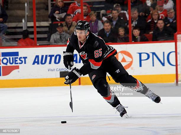 Ron Hainsey of the Carolina Hurricanes moves the puck on the ice during their NHL game against the Columbus Blue Jackets at PNC Arena on January 27...