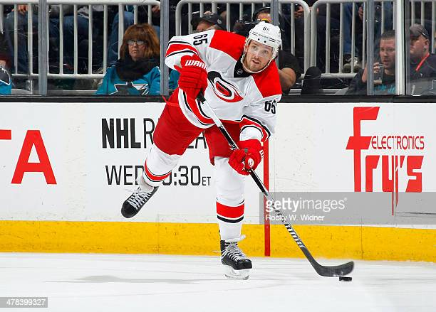 Ron Hainsey of the Carolina Hurricanes passes the puck against the San Jose Sharks at SAP Center on March 4 2014 in San Jose California