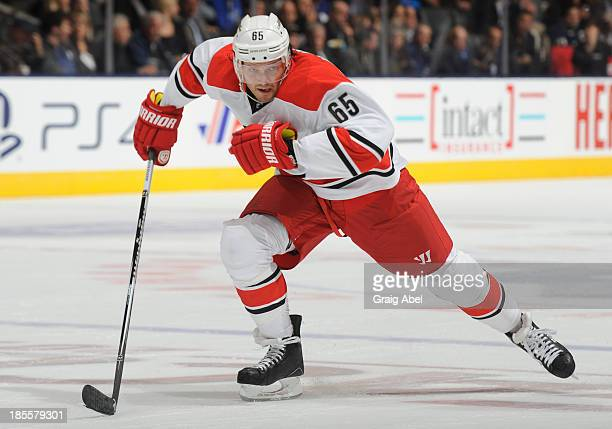 Ron Hainsey of the Carolina Hurricanes skates during NHL game action against the Toronto Maple Leafs October 17 2013 at Air Canada Centre in Toronto...