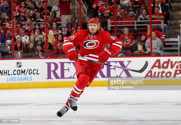 Ron Hainsey of the Carolina Hurricanes skates for position on the ice during their NHL game against the New York Islanders at PNC Arena on October 10...