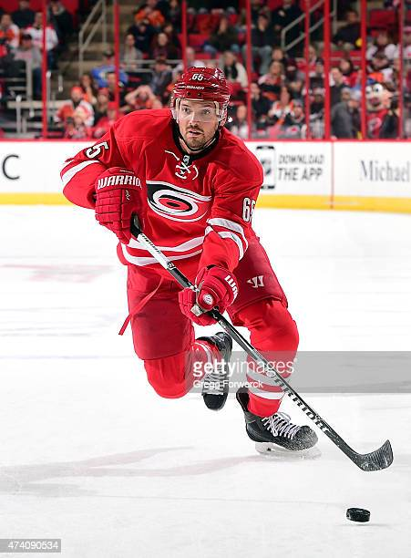 Ron Hainsey of the Carolina Hurricanes skates hard with the puck into the Philadelphia Flyers defensive zone during an NHL game on February 24 2015...