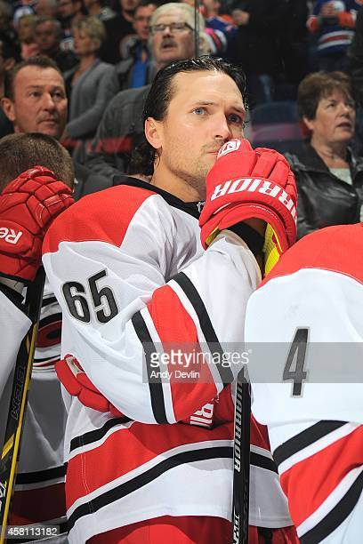 Ron Hainsey of the Carolina Hurricanes stands for the singing of the national anthem prior to a game against the Edmonton Oilers on October 24 2014...